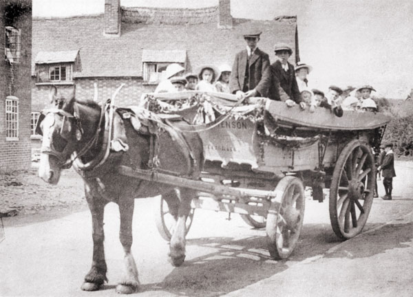 hensons waggon in front of the church of england school in burbage