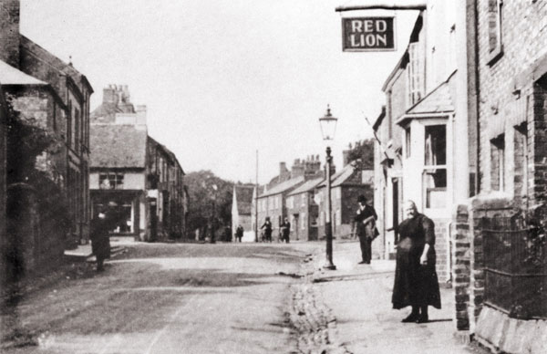 mrs mary godfrey standing outside the red lion along windsor street