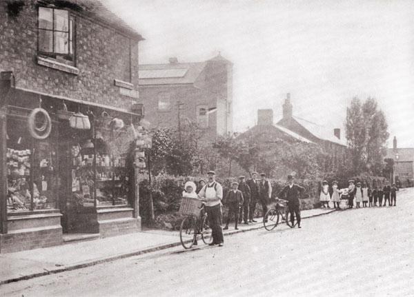 mr newcombe outside his general store along windsor street in burbage