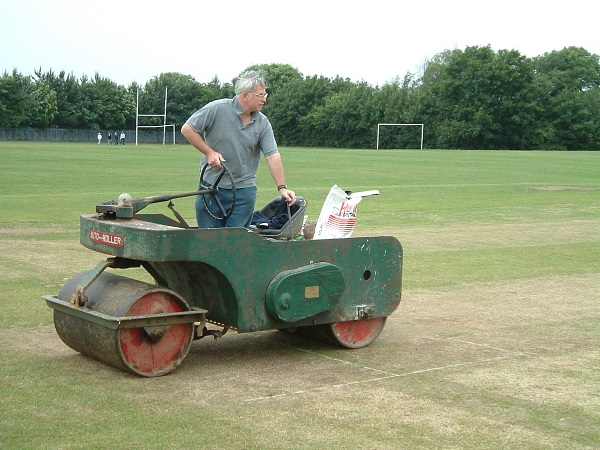Ian Crisp at work with the 'iron horse' rolling the wicket