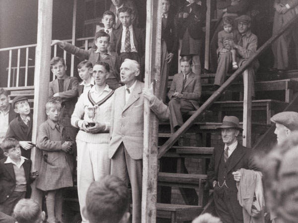 Harold Alsop receiving the winner's trophy in 1945 at Kirkby Road, Barwell.