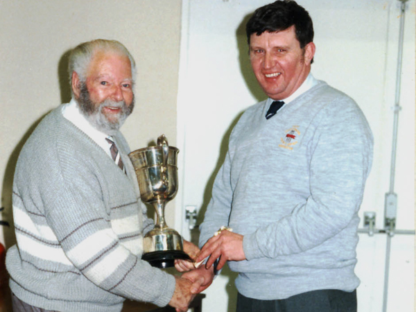 Fred being congratulated by Keith Towers when he was awarded the Ernest Wright Trophy in 1998