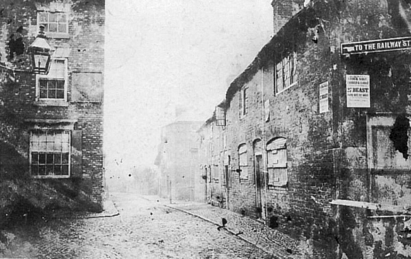 Station Road from the Market Place, about 1872, with the Globe Inn to the left.