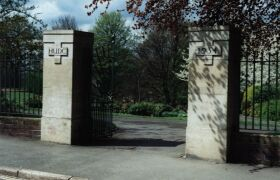 Hollycroft Park gates on Shakespeare Drive, inscribed HUDC-1934