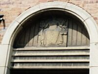 Magistrates entrance, concrete panel with figure of Justice by J. H. Morcom
