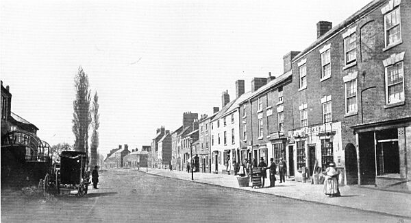 Regent Street looking towards Coventry Road, about 1860. On the left is Fulleylove's carriage works and beyond, the row of beech trees which was a distinguishing feature of Hinckley's townscape for much of the nineteenth century.