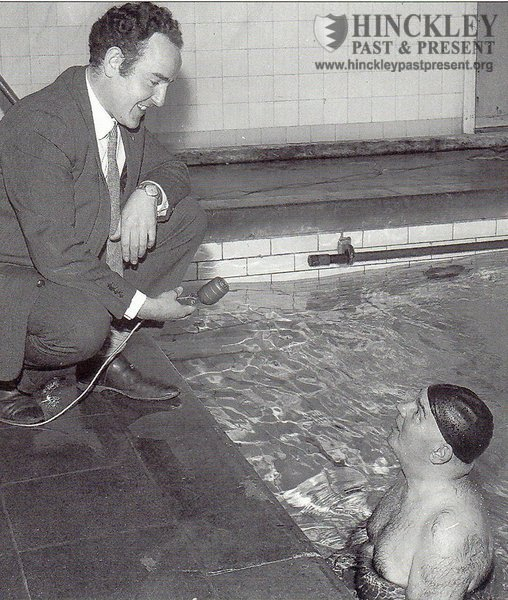 Swimming instructor Ted Ellis being interviewed